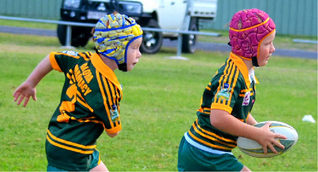 GAME ON: Wattles Under 7 players Jack Dalsanto and Nixon Eastwell (with ball) will pull the boots on tomorrow in the rugby league Super Saturday at Platz Oval. Photo: Leeanne's Photography