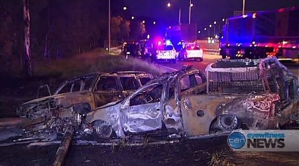 Police have charged four after a chase led to a dog squad vehicle being destroyed by fire.