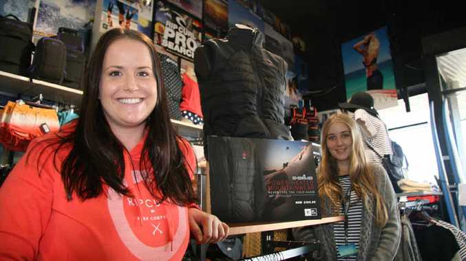 COOLING DOWN: From left, Ripcurl Yeppoon staff members Amie Gleeson and Shayla Bulloch with some of their winter range, as temperatures are about to drop in the region.