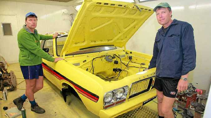 DRIVEN: When they are not rescuing koalas or running their business, twins brothers Ray (left) and Murray Chambers love to work on restoring cars. This Chrysler Drifter ute is Ray's pride and joy.