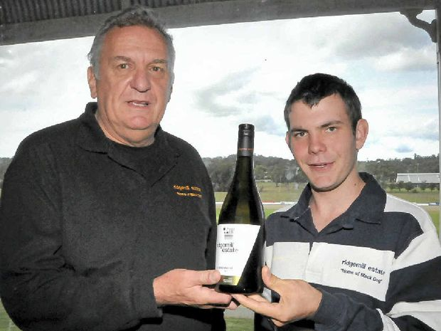 TOP DROP: Ridgemill Estate owner Martin Cooper with Jacob Veness at the public wine tasting in Toowoomba. Their chardonnay variety was named the Best Queensland White wine for the variety at Wine Show recently.