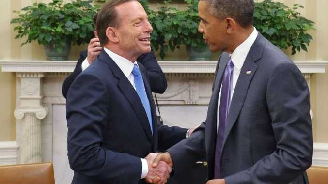 US President Barack Obama and Australian Prime Minister Tony Abbott shake hands following a bilateral meeting in the Oval Office of the White House on June 12, 2014 in Washington, DC.