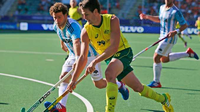 Australia's Matt Gohdes, right, and Argentina's Guillermo Schickendantz, left, vie for the ball during the Field Hockey World Cup semifinal match men between the Australia and Argentina in The Hague, Netherlands, Friday, June 13, 2014. Australia won the match with a 5-1 score and will play The Netherlands in Sunday's final.
