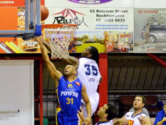 Cardell MacFarland jumps to shoot during the mens Gladstone Power as Rockets tower Ray Turner swats it away.