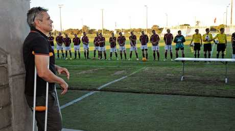 Sen Const Len Elliott looks out at the competing teams at the charity soccer match for the injured officer at Stockland Park. Photo: Iain Curry / Sunshine Coast Daily