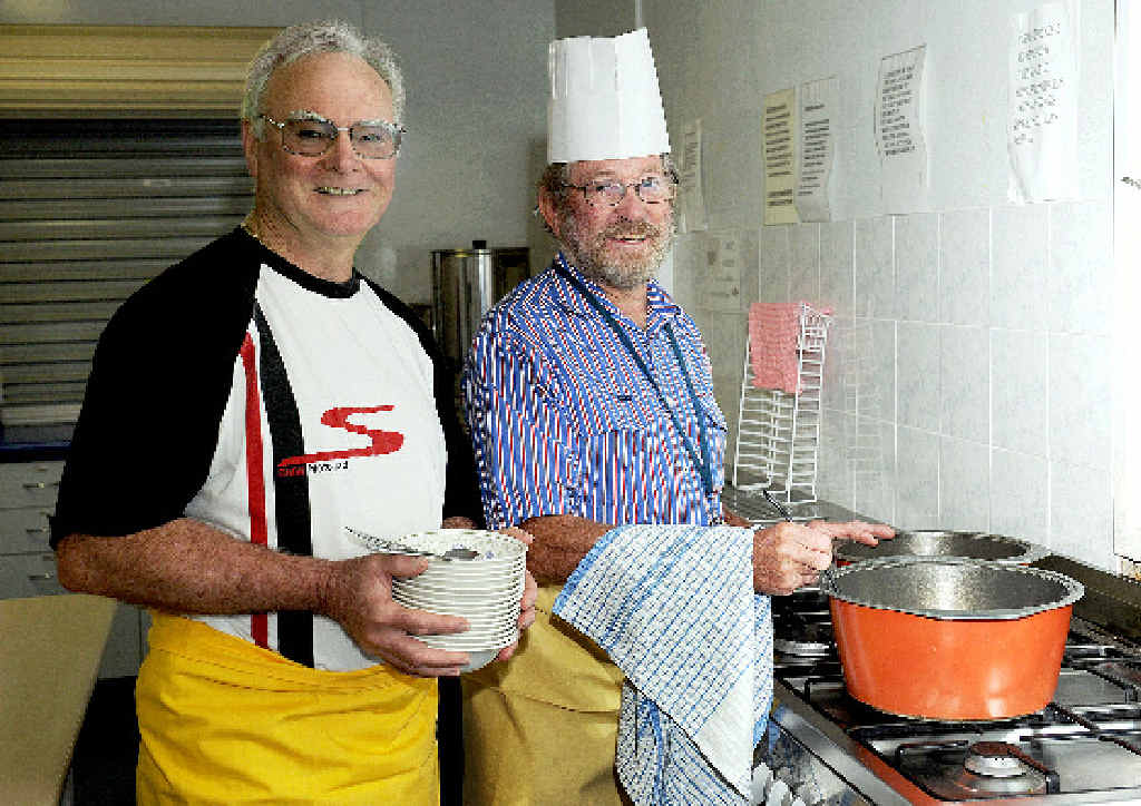 Frank Burkett and Perry Perrement in the Maryborough Catholic Parish Hall preparing soup for the Sew PNG soup night on June 28.