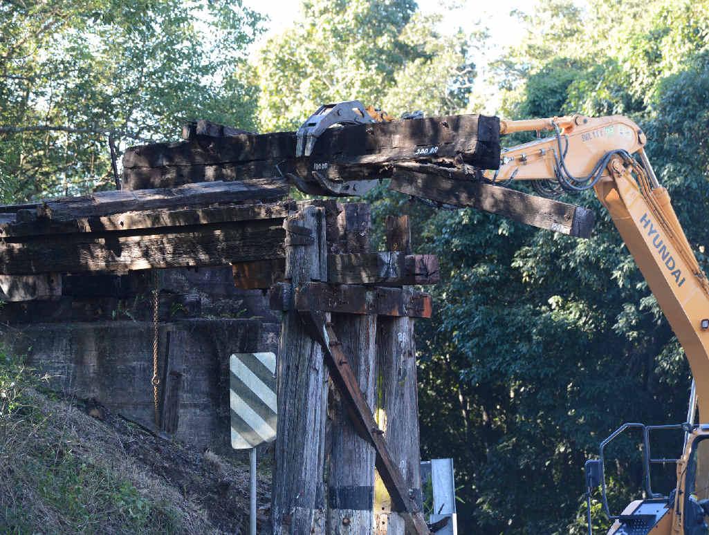 MODERNISATION: An excavator dismantles the railway bridge on Woodlawn Rd, North Lismore.
