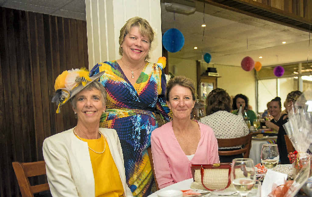 STYLISH: Rosemary Frediksen, Anne McCosker (centre) and Leonie Sheedy enjoy their time at the Vintage Fashion High Tea which was held to support the Cancer Council.
