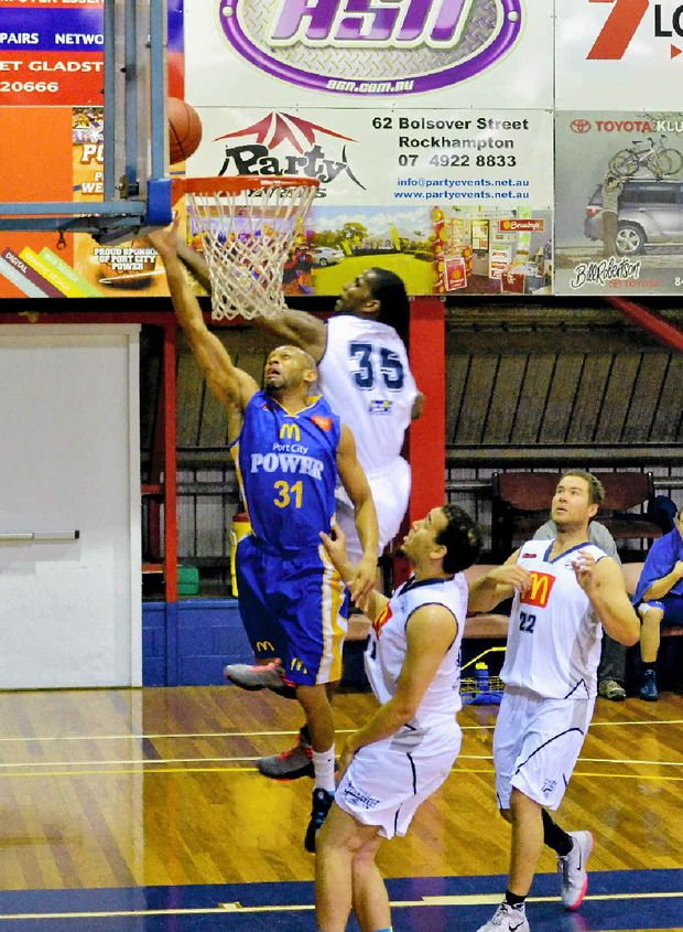 UP HIGH: Cardell MacFarland jumps to shoot during the men's Gladstone Power against Rockhampton basketball game at Kev Broome Stadium.