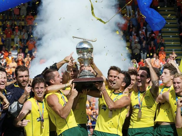 Jeremy Hawyard (left) and Mark Knowles (right) lift the World Cup