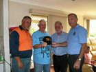 HELPING HAND: Hanson driver Brian Smith, Mark Wilson, Wayne Forno and TWU NSW Branch president George Clarke.