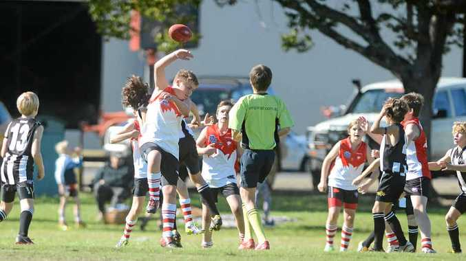 MAIN PICTURE: Players battle to get the upper hand in AFL Northern Rivers Juniors competition.