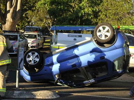 This car landed on its roof after a collision in Toowoomba this morning.