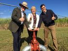 Minister for Agriculture John McVeigh, Member for Maryborough Anne Maddern and MSF Sugar chief executive Mike Barry turn on the main valve to allow irrigation water to flow to a Maryborough cane farm.