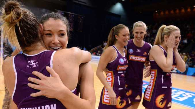 GLORY BECKONS: Verity Simmons celebrates with fellow Firebird Kim Ravillion after Monday night's preliminary final win. PHOTO: AAP Image/Dan Peled