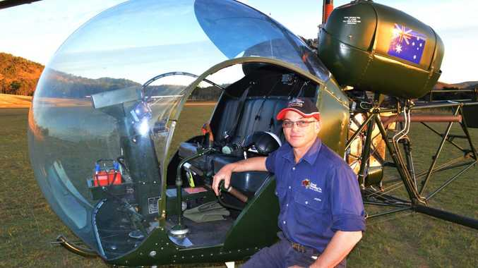 Ron Creed with his Bell 47 helicopter, a valued workhorse on the Creed family property west of Ambrose.