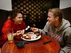 Rockhampton Grammar students Ruth Beaumont and Gemma Bleney get warm and cosy during winter by eating chocolate strawberries and marshmallows at the Giddy Goat Caf . Photo Allan Reinikka / The Morning Bulletin