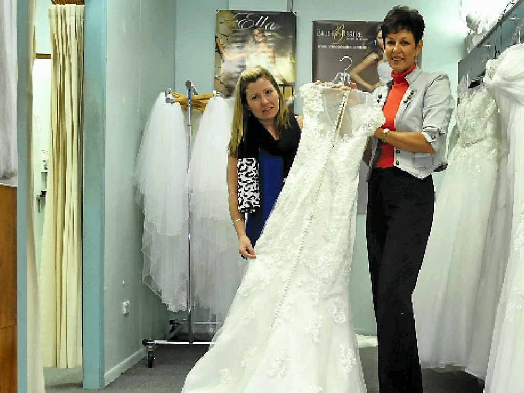 ABSOLUTELY GORGEOUS: Bonnie Sills and Ceona Mills admire the newest addition to the Gladstone Bridal range.