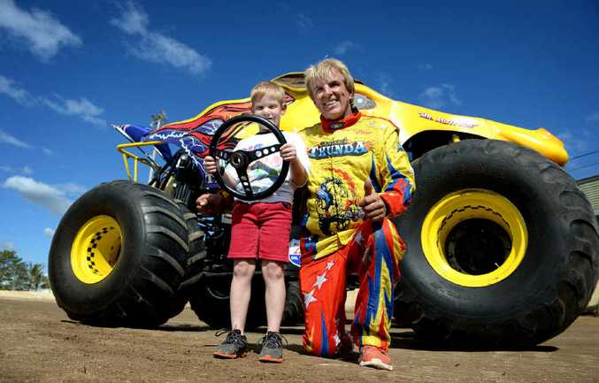 RIDE OF A LIFETIME: Connor Cox got behind the wheel of monster truck Outback Thunda with driver Clive Featherby.