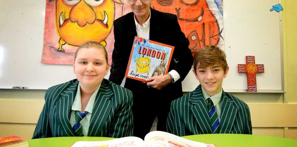 Author and illustrator Leigh Hobbs with Lauren Bowen, Year 8 and Ben Childes, Year 8. Photo Allan Reinikka / The Morning Bulletin