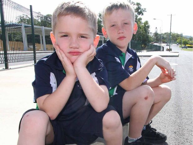 FORGOTTEN: Thomas (5) and Ethan (8) Brown were left behind at the Tabone St bus stop.
