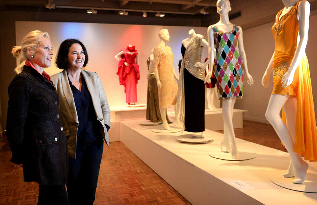 FASHION FLAIR: Darnell Collection owner and curator Charlotte Smith and former Vogue editor-in-chief Kirstie Clements with some of the striking designs on show in the Rockhampton Art Gallery exhibition, Some Kind of Wonderful: 80s Fashion from the Darnell Collection.