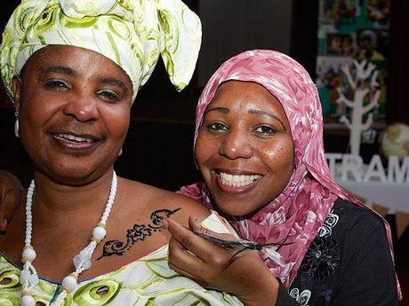 Adolphine Kishaba gets tattooed by Henna artist Elham Zaki.