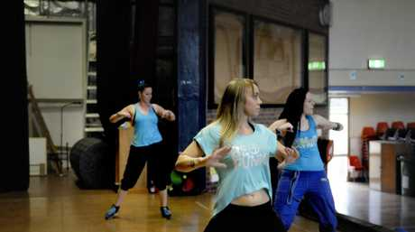 Casey Etheridge leads the Zumba fitness fundraiser at Centenary heights High School hall. Photo: Bev Lacey / The Chronicle