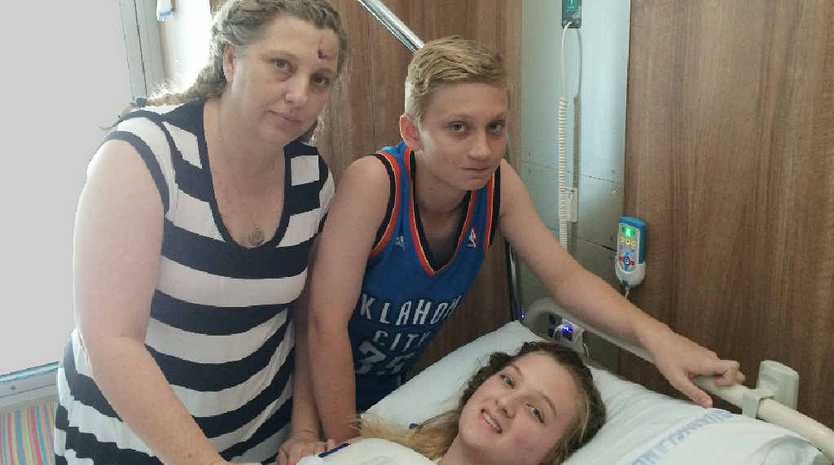 ROAD TO RECOVERY: Rockhampton's Halliday family of mum Fiona, Chandler and daughter Elysse who is in Mackay Base Hospital with spinal injuries. Inset: The RACQ CQ Rescue choppern at the crash scene.