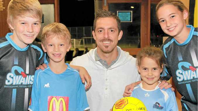 WELCOME BACK: Former Maroochydore Soccer Club junior, Jerrad Tyson, presented a cheque for $10,000 to his grassroots football club after winning a ME Bank Green Card prize in the A-League. He is pictured with (L-R) Oliver Pateman, 12, Jai Hunt, 7, Danika Danger, 5, and Teyl Danger, 12.