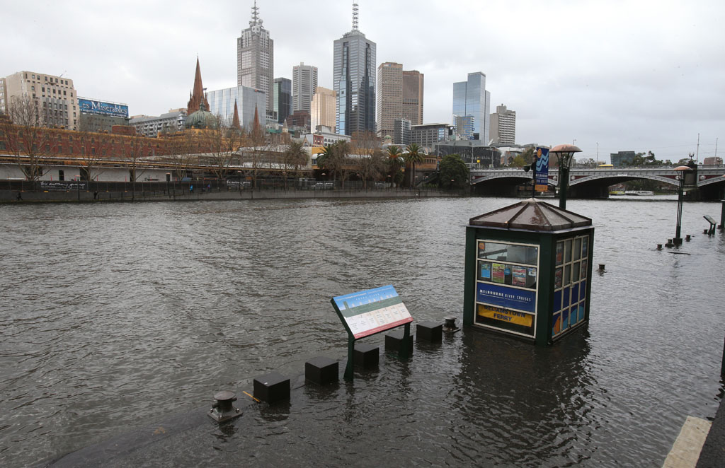 A flooded ferry terminal on the banks of the Yarra river in Melbourne, Tuesday, June 24. 2014. Extreme weather with strong winds has been hitting Melbourne and parts of Victoria.