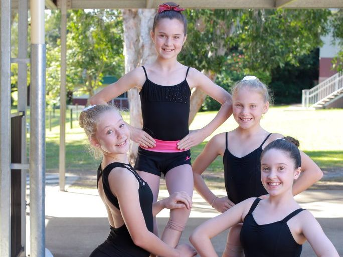 Young members of the Queensland calisthenics team training for the national titles at the Chevallum State School hall: (L-R) Piper Hertslet, Whitney Edward, Abbey Woods and Chelsea Humphreys. Photo: Brett Wortman / Sunshine Coast Daily