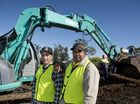 Toowoomba men Jay Himstedt (left) and Troy Turnbull take part in a program which helps them gain earthmoving qualifications while improving facilities at the Jack Martin Centre.