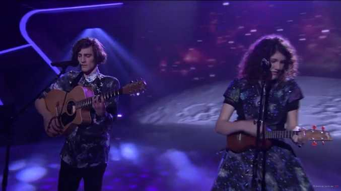 A still of Gabriel and Cecilia Brandolini performing Walking on a Dream on The Voice.