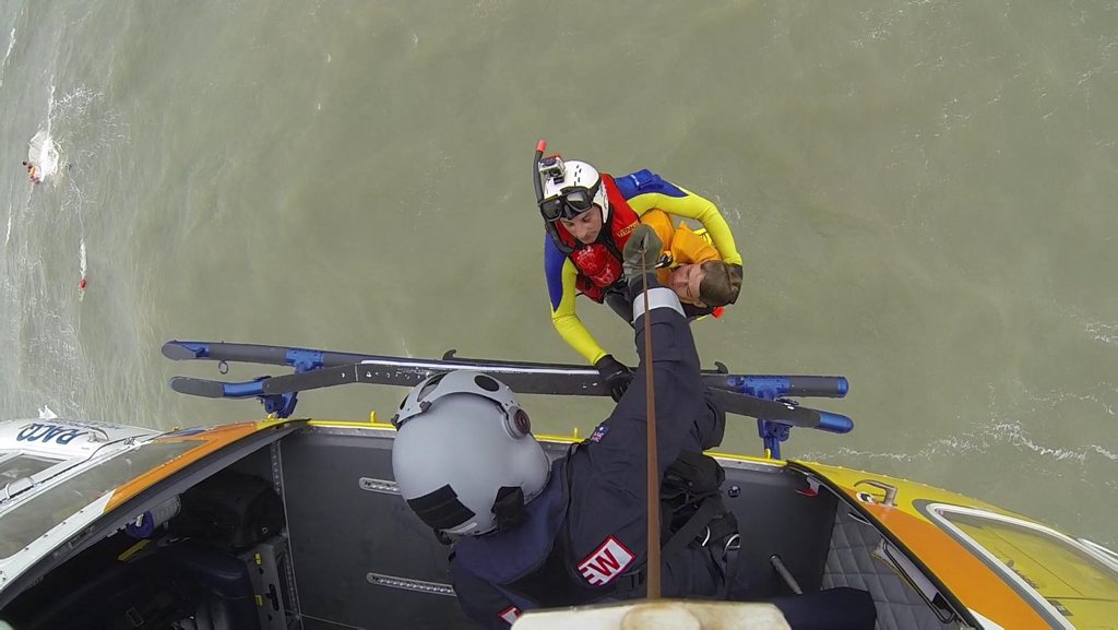 RACQ Capricorn Rescue winching a boatie to safety earlier this month.