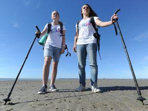 Teenage girls trekking the length of Fraser Island