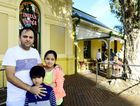 TIME TO STOP: Raj Sharma with his two children after a racially motivated attack at his restaurant yesterday.