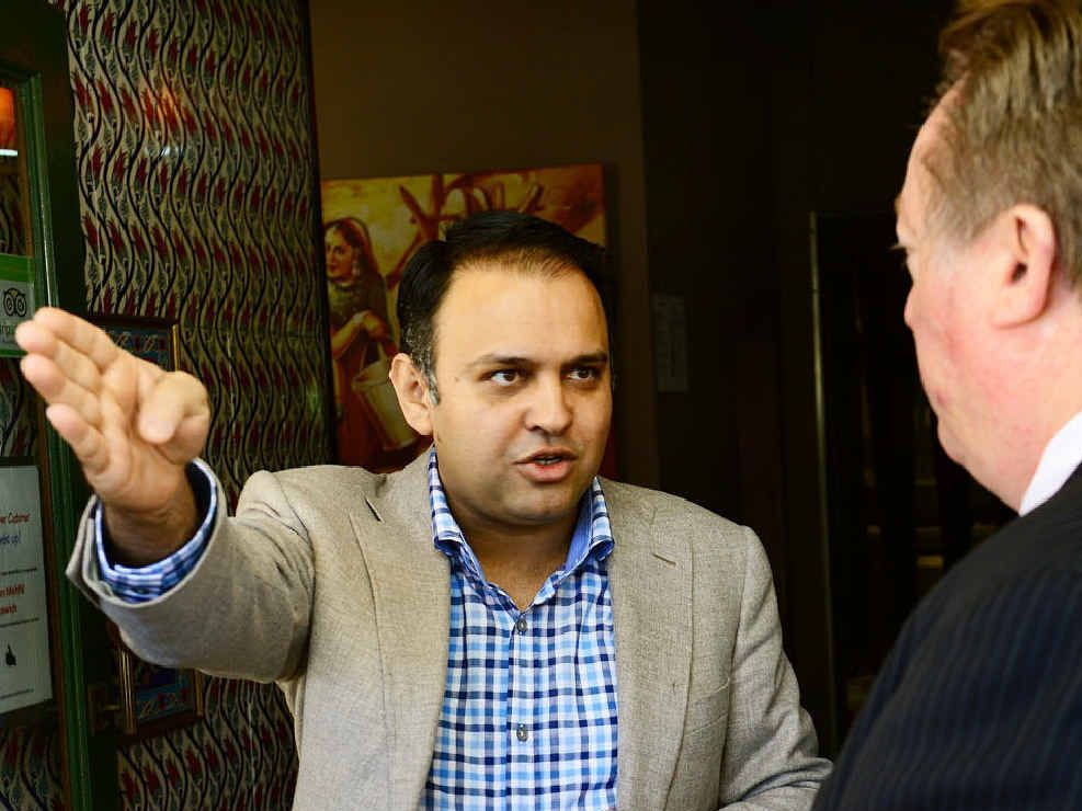 QUICK RESPONSE: Multicultural Affairs Minister Glen Elmes met with Raj Sharma after a racist attack on the businessman and his family.