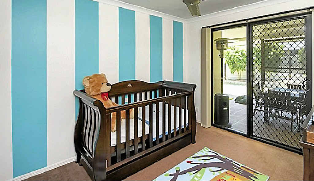 FIT FOR A FAMILY: Jessica and Cameron's baby area is just one of the rooms with timber features and access to the outdoors.