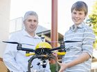 Father and son duo Mark and Neil Gardyne with a drone they use on their farms in New Zealand. Photo Contributed