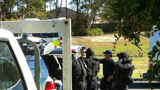 Special emergency response team act at a siege situation at Caboolture.