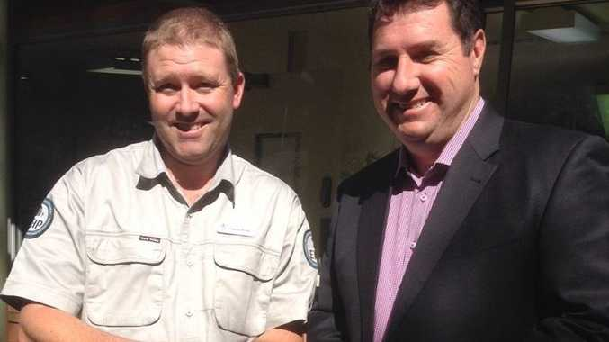 Environment Minister Andrew Powell (right) and wildlife officer Cameron Wregg, pictured with a turtle, talk about a wildlife crime crackdown. Photo: contributed.