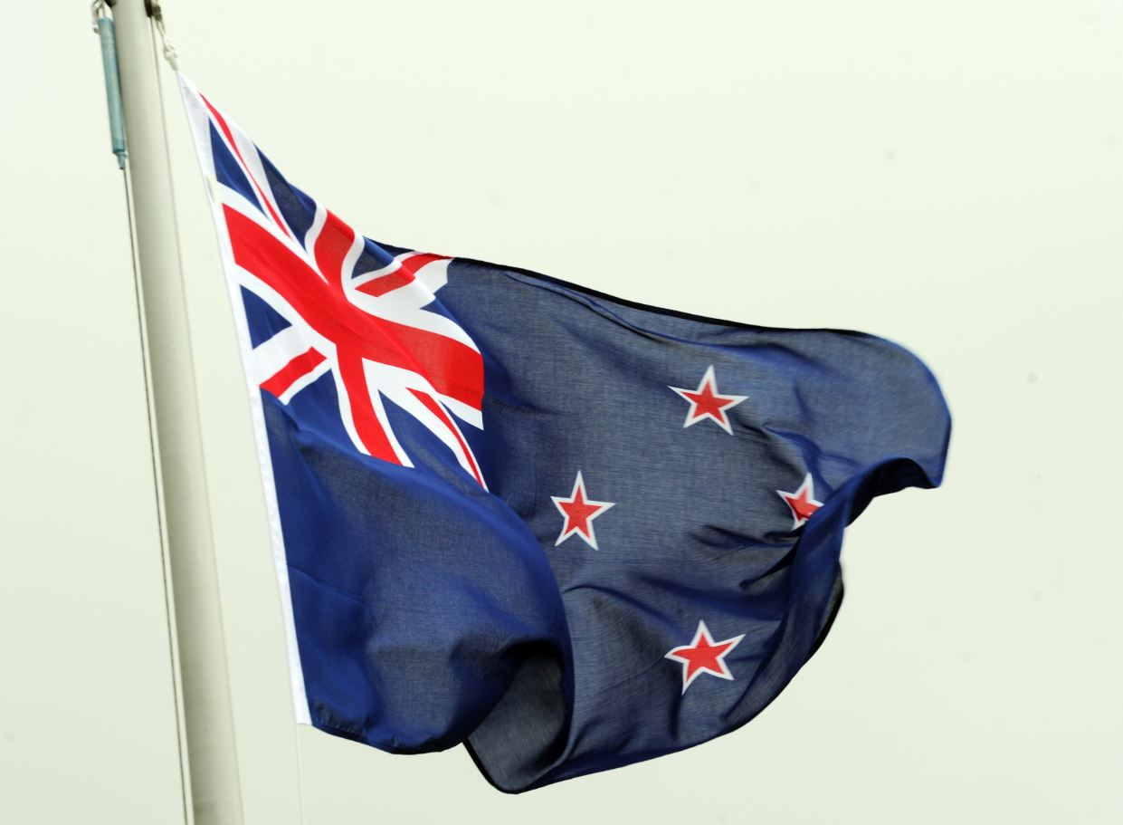 The New Zealand flag flies over the National Commemorative Anzac Day Service, on the forecourt of Parliament, Wellington, New Zealand, Friday, April 25, 2014.