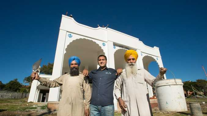 GETTING CLOSER: Jagtar Singh and Charn Singh with builder Andrew Hundal on site at Australia's first Sikh temple, with upgrades nearing completion. Photo: Trevor Veale / Coffs Coast Advocate