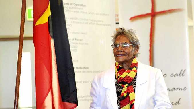 GOD'S WORK: Bundjalung Elder Aunty Dorrie raises the Aboriginal Flag at the Salvation Army Church in Goonellabah in a historic ceremony.