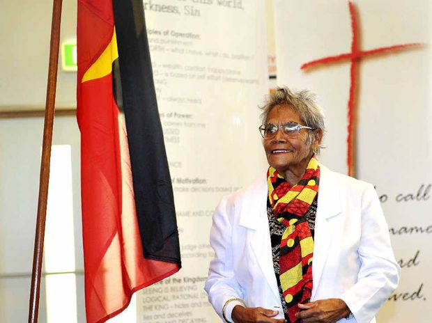 GOD'S WORK: Bundjalung Elder Aunty Dorrie raises the Aboriginal Flag at the Salvation Army Church in Goonellabah in a historic ceremony.