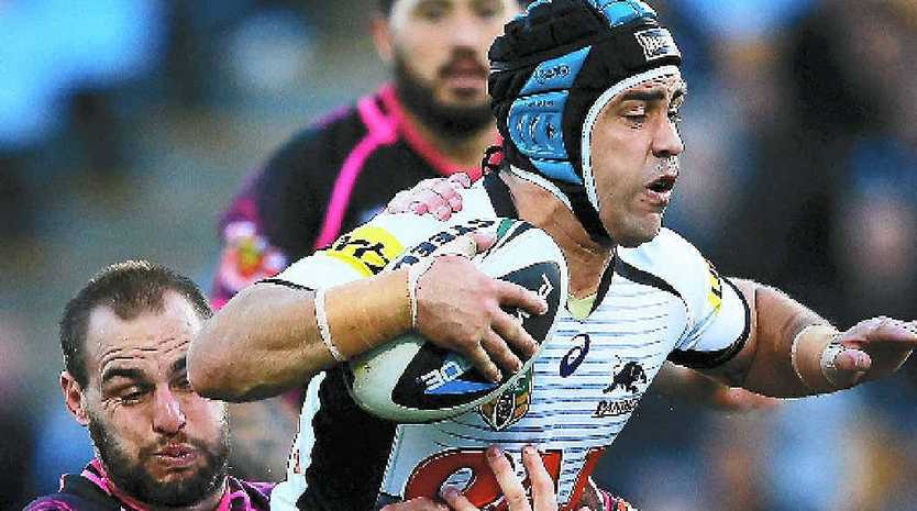 Jamie Soward of the Panthers charges forward against the Warriors yesterday.