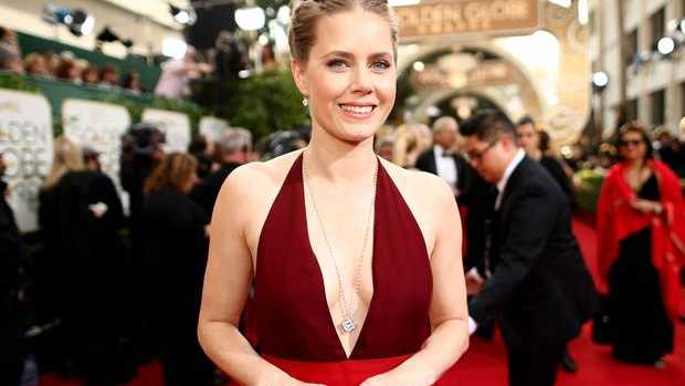 AMERICAN actress Amy Adams has given away her first-class seat to a US soldier