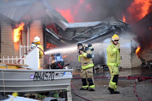AVOCA FIRE: Emergency services attend the scene of a fire which started in a shed and destroyed an adjoining building. Photo: Max Fleet / NewsMail