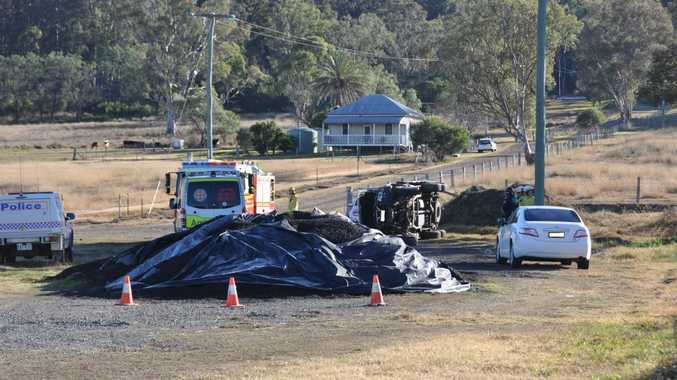 TRAGIC SCENE: A man in his 30s has been killed in a single-vehicle rollover this morning on the Warwick-Allora Rd. Photo Candyce Braithwaite / Warwick Daily News